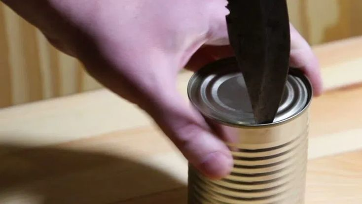 opening can with knife